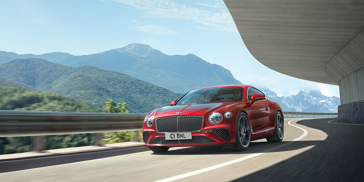 CONTINENTAL-GT-V8-DRIVING-BY-MOUNTAINS